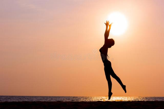 woman-silhouette-jumping-sea-background-sunset-side-view-back-lit-61584325